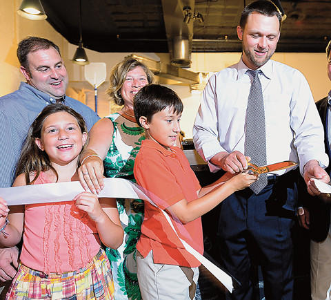 A ribbon was cut Tuesday to mark the opening of Flying Pie Co. restaurant. Owners Greg and Marjorie Kane and their children, Lauren and Charlie, assist Hagerstown Mayor David S. Gysberts with the ceremonial cut.
