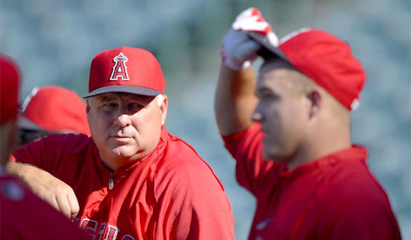 "Mike Trout, right, won't be participating in the Home Run Derby this year, an event Manager Mike Scioscia, left, likened to ""hitting 10 buckets of balls"" at a driving range."
