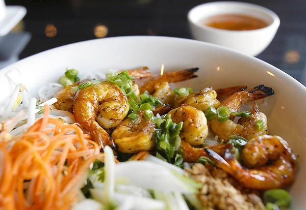 The Bun Tom Nuong is grilled shrimp over vermicelli, lettuce, bean sprouts, chopped cucumber and cilantro and topped with diluted lime fish sauce at the Hue Oi Vietnamese Cuisine in Fountain Valley.
