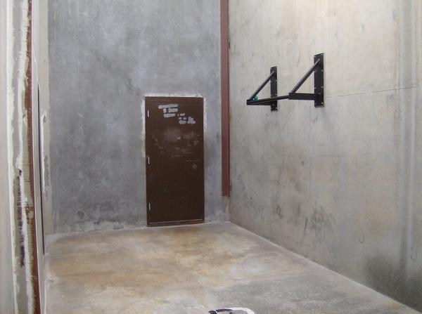 An enclosed yard where California prison inmates in solitary confinement are allowed to exercise, one at a time. After the 2011 hunger strikes, corrections officials agreed to add a pull-up bar and small handball.