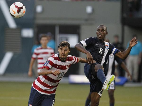 U.S. forward Chris Wondolowski (19) of the U.S. prepares to head the ball for a goal against Elroy Smith of Belize.