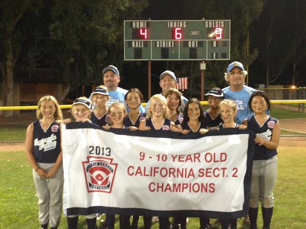 The Crescenta Valley 9-10 softball team poses for a photo after winning the Section 2 tournament.