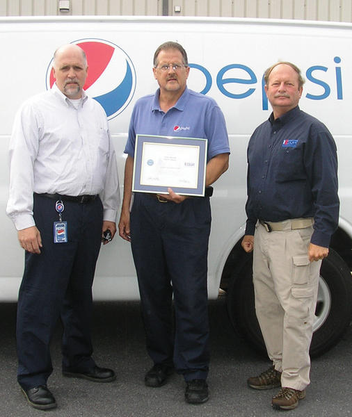 From left, Pepsi Co. Territory Sales Manager Kerry Lamp; Gary Kerns, warehouse manager for Pepsi Co. in Williamsport; and Ron Pitts, Western Maryland Area chairman for Maryland Employer Support of the Guard and Reserve, celebrate Kerns' Patriot Award for support of an employee serving in the Maryland Army National Guard.