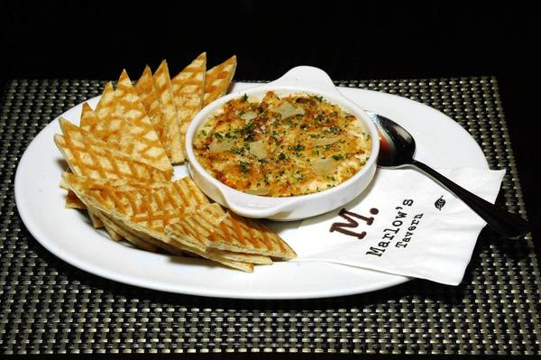 Serve Marlow's Lump Crab & Lobster Dip with crisp bread.