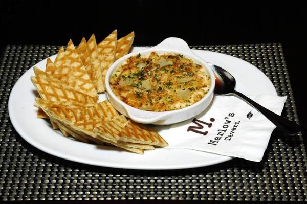 Serve Marlow's Lump Crab & Lobster Dip with crisp bread.