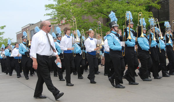 Carl Brien keeps a close eye on the trombone section during the 2012 Memorial Day parade in downtown Petoskey. Brien is retiring after 37 years as Petoskey's band director.
