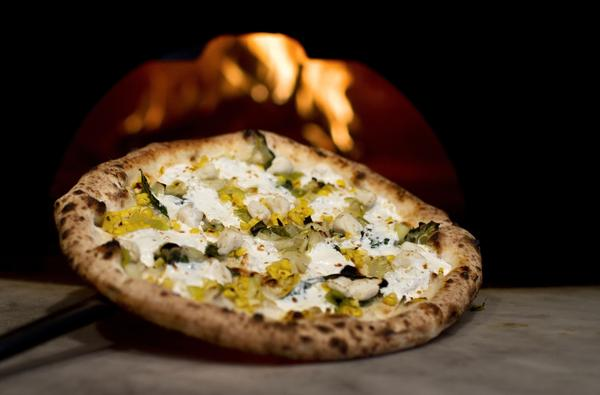 The Granchio pizza at Verde features omemade mozzarella, lump crab meat, roasted corn, leeks, fennel, chives and extra virgin olive oil