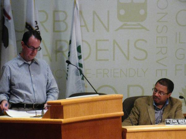 Oak Park Urban Planner Doug Kaarre, left, discusses historic surveys with the Oak Park Village Board at a July 1 meeting. If surveyed areas meet historic standards, the board could attempt to prevent expansion of the Eisenhower Expressway near them.