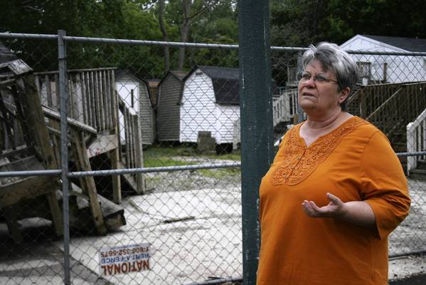 Glenview's Sunset Village longtime resident Anita Noel shows numerous vacated parts of her community. The mobile home park recently got new owners.