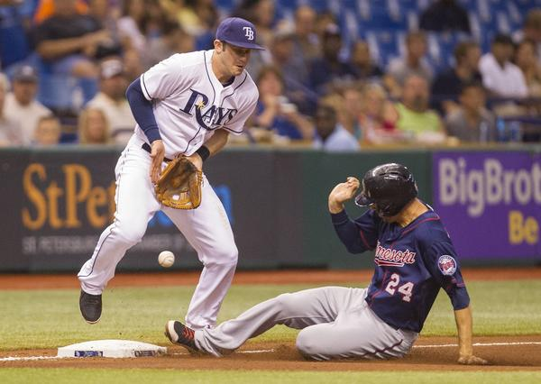 Evan Longoria of the Tampa Bay Rays can't handle a throw, as Trevor Plouffe of the Minnesota Twins slides into third during the fourth at Tropicana Field in St. Petersburg, Florida, Monday, July 8, 2013. (James Borchuck/Tampa Bay Times/MCT)