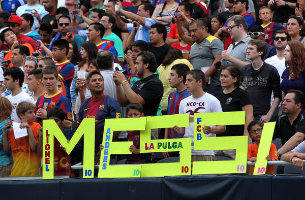 Fans show support for Lionel Messi during the Messi & Friends charity soccer game at Soldier Field in Chicago on Saturday.