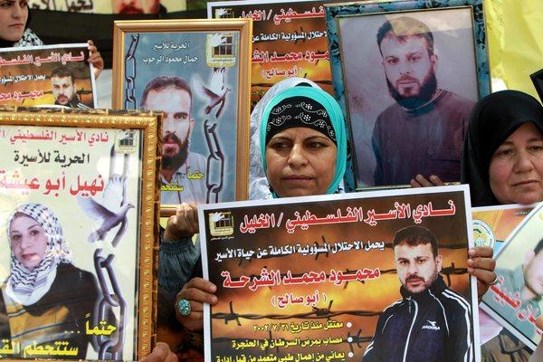Palestinians hold a rally Monday in the West Bank city of Hebron to show solidarity with prisoners held by Israel.