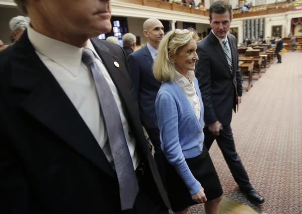 The Texas House gave final approval Wednesday to a restrictive abortion bill. Above, Republican Rep. Jodie Laubenberg, a sponsor of the measure, is shown leaving the House floor Tuesday night after the legislation won provisional approval.