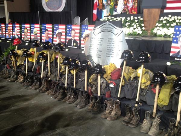 A tribute displayed at Tuesday's memorial, included the firefighters' helmets, scuffed boots, wildland turnouts and axes.