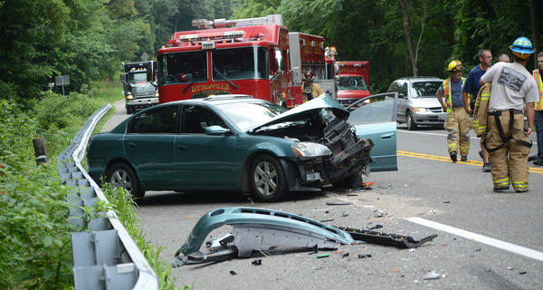 A Nissan Altima, left, was heavily damaged in a three-vehicle crash Wednesday morning at the intersection of U.S. 40 and Mount Lena Road. Four people were taken to Meritus Medical Center.