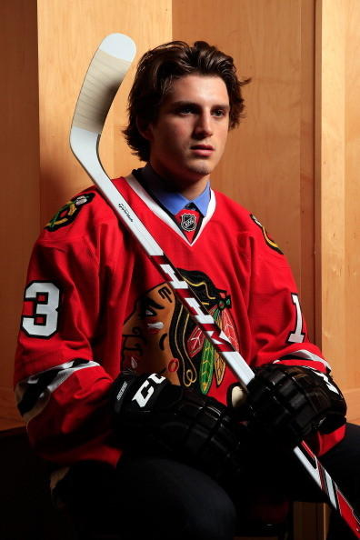 Ryan Hartman poses for a portrait after being selected in the first round by the Blackhawks during the 2013 NHL Draft. (Getty Images)