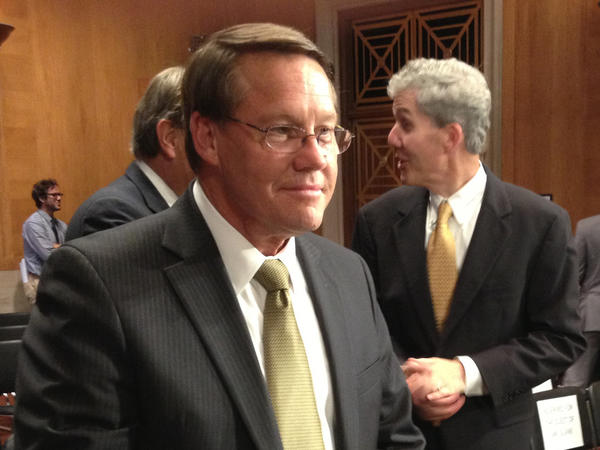 Smithfield Foods CEO Larry Pope arrives for a Senate hearing to discuss his company's potential sale to a Chinese buyer.
