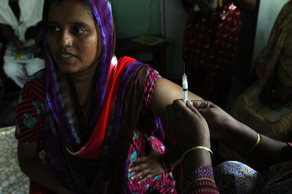 A mother of two in Matlab, Bangladesh, prepares to receive a hormone shot that will protect her from pregnancy for 3 months. Bangladesh has made access to contraceptives a priority, unlike many fast-growing nations in Africa.