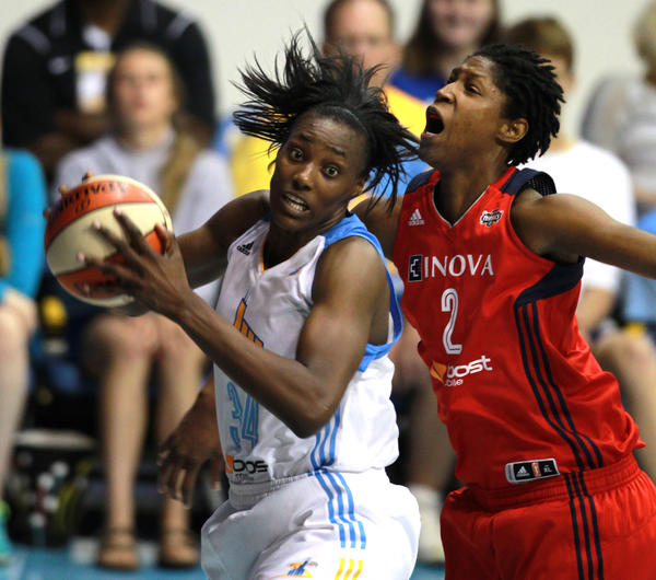 The Sky's Sylvia Fowles comes away with a rebound against the Mystics' Michelle Snow.