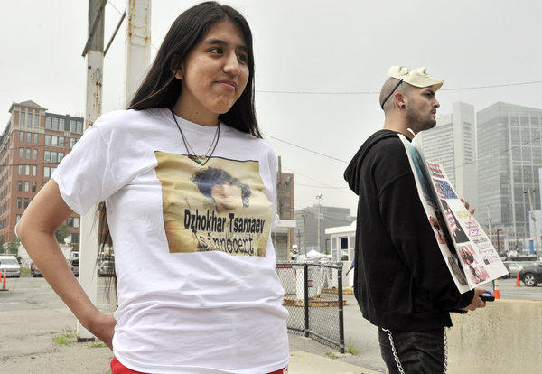 Jennifer Michio, left, from Mashantucket, Conn., and Duke La Touf, right, of Las Vegas, stand in support of Boston Marathon bombing suspect Dzhokhar Tsarnaev outside the federal courthouse before his arraignment Wednesday in Boston.