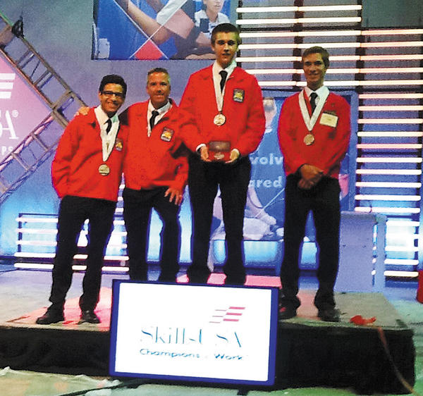 Washington County Technical High School's three-member team won a silver medal in Career Pathways Showcase  Business, Management and Technology, at the recent National SkillsUSA Competition in Kansas City. They are, from left, Phillip McField, adviser David Long, Brian Tew and Peter Crampton.