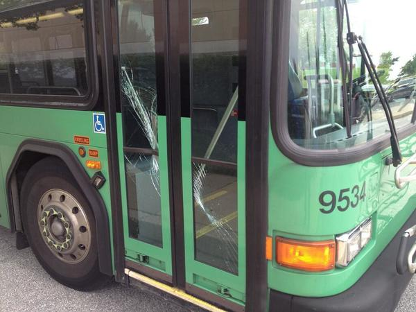 Damage to the door of a Howard Transit bus allegedly caused by Howard Carvel Smith, the man identified as being shot by Howard County Police after a confrontation inside the BJ's Warehouse Club in Columbia.