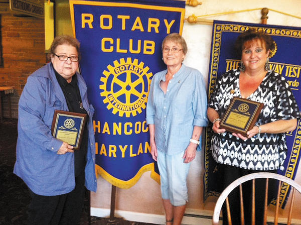 "Hancock Rotary Club Presdident Carmon Gordon, center, presents service awards to the Hinckle sisters, Barbara Hinckle, left, and Rhonda ""Susie"" Hinckle."