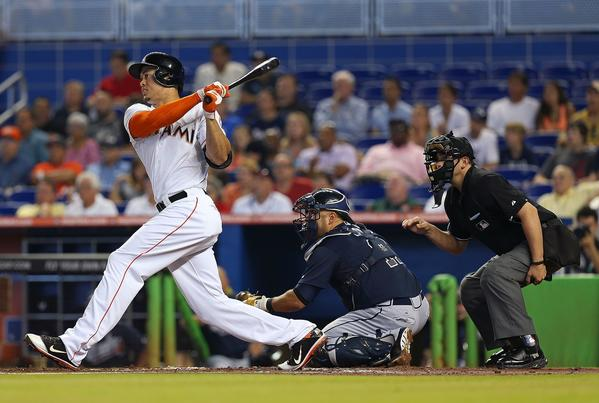 MIAMI, FL - JULY 10: Giancarlo Stanton #27 of the Miami Marlins hits a two RBI double during a game against the Atlanta Braves at Marlins Park on July 10, 2013 in Miami, Florida. (Photo by Mike Ehrmann/Getty Images) ORG XMIT: 163494517