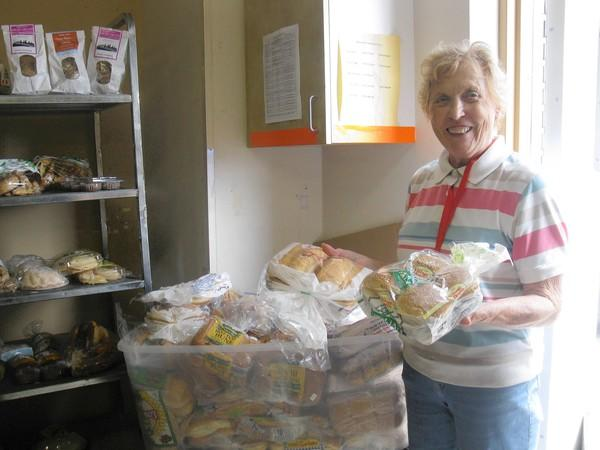 "Kathy Purdy says she has volunteered at the People's Resource Center food pantry for three years because ""I live here and I want to help."""