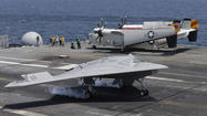 Navy drone X-47B lands on carrier deck in historic first