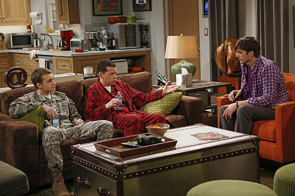 "From left, Jake Harper (Angus T. Jones), Alan Harper (Jon Cryer), and Walden Schmidt (Ashton Kutcher) in ""Two and a Half Men."""