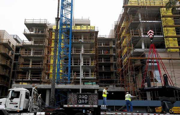 Construction continues on the 93-unit complex called the Seychelle, one of two complexes that will rise over stores and restaurants along Ocean Boulevard in Santa Monica.