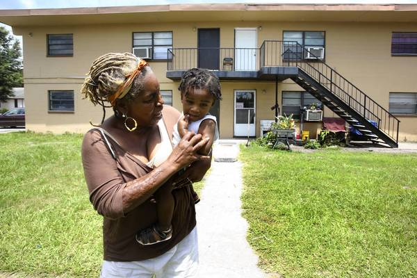Awanda Griffin with her grandson Quincy Robinson in front of her apartment house in west Orlando.
