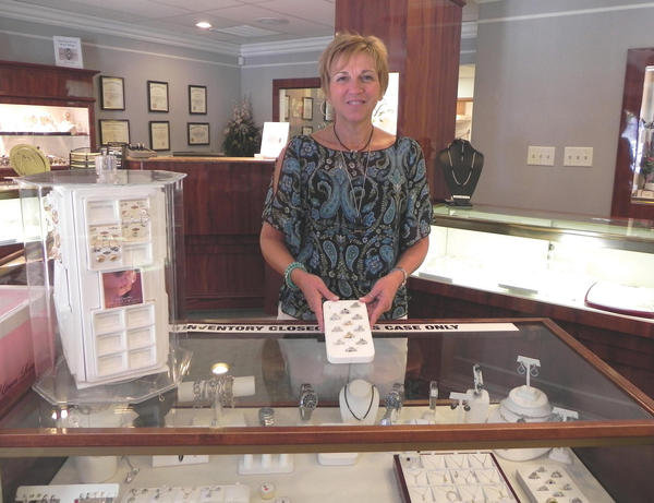 Teresa McCauley, store manager of The Jewelry Shop at 18 E. Baltimore St., Greencastle (Pa.), gets ready for Sidewalk Days in downtown Greencastle on Friday and Saturday.