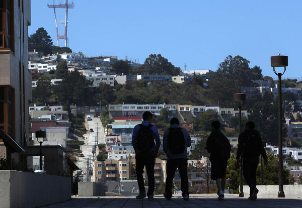 Students walk along the campus of City College of San Francisco, which is in danger of losing its accreditation.