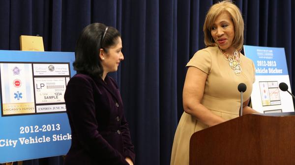 Nielsen Co. Senior Vice President Cheryl Pearson-McNeil, right, talks with Chicago City Clerk Susana Mendoza at the April 2012 unveiling of the Chicago city sticker.