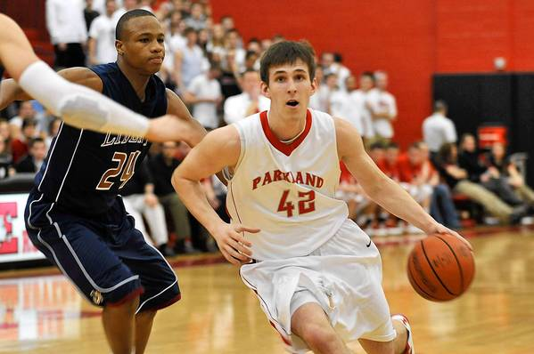 Parkland's Justin Zajko (42) drives the ball past Liberty's DeShawn Oyeniyi (24) on February 13, 2013.