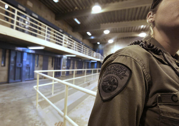 A corrections officer is shown in one of the housing units at Pelican Bay State Prison.