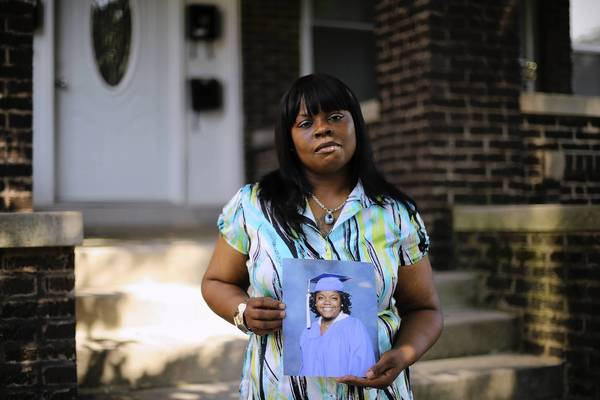 Nortasha Stingley holds a portrait of her daughter, Marissa Boyd-Stingley, who was killed when she was shot in the head June 25 while riding with friends.