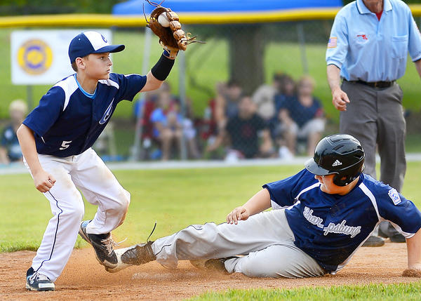 Sharpsburg base runner T.J. Reeder, right, is out at second base as Conococheague infielder Justin Taylor, left, gets the force out in the top of the fourth inning on Wednesday during Conococheague's 10-5 victory to win the Maryland District 1 title.