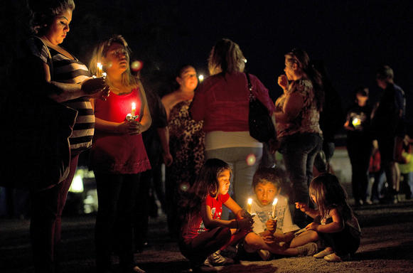 Community members hold candles after a vigil for 11-year-old Terry Dewayne Smith, whose body was believed to have been found after an extensive search.