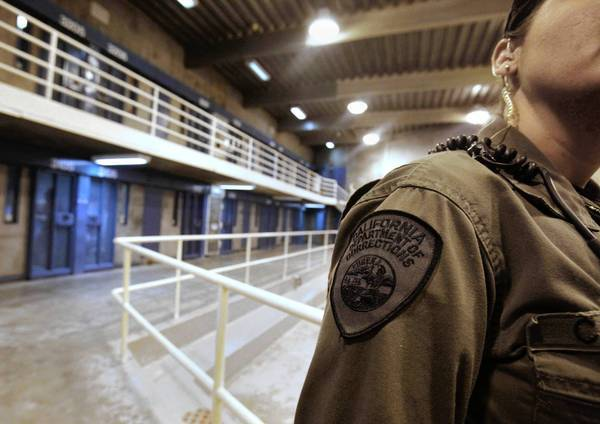 A corrections officer is seen in one of the housing units at Pelican Bay State Prison near Crescent City, Calif. A meal strike by thousands of state inmates originated at the high-security prison.