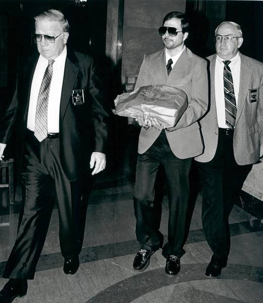 Mitchell DiVentura (center), arriving at a Luzerne County courtroom in this undated photo, continues to appeal his Northampton County Court murder conviction for strangling his wife in 1976. He has been incarcerated in a state prison for 37 years.