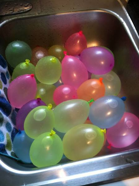 The sink full of just filled water balloons is seen here, moments before the big water fight in my driveway.