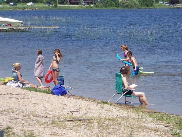 Swimmers cool off at the Little Traverse Township Park on Crooked Lake. While swimmers itch is more prevalent at shallower lakes, such as Crooked Lake, there are ways to protect yourself.