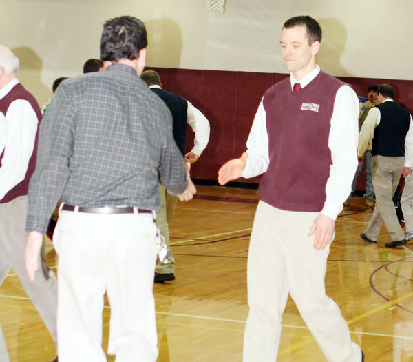 Former Charlevoix High School boys basketball coach Adam Wood (right) was named Harbor Springs athletic director by a committee board earlier this week. Wood coached the previous three years in Charlevoix as the varsity boys coach and was the freshman coach prior to the varsity post.