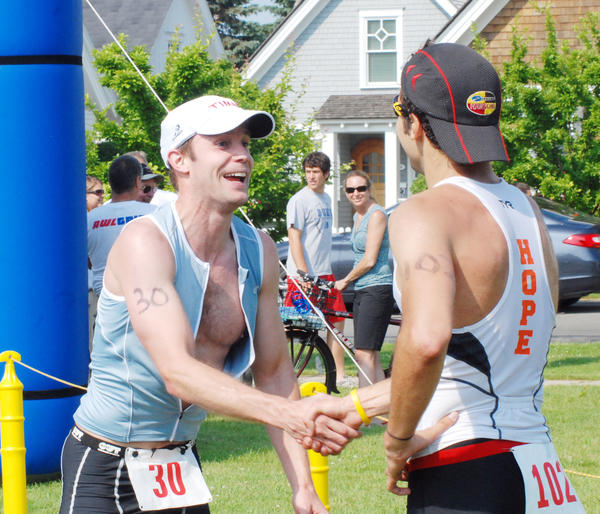 Andrew Bowman (left) of Harbor Springs is the defending overall male champion in the Little Traverse Triathlon, as he finished the course in one hour, 26 minutes to take the crown in 2012.