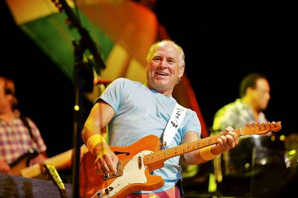 On a previous visit, Jimmy Buffett entertains fans at the Farm Bureau Live at Virginia Beach.