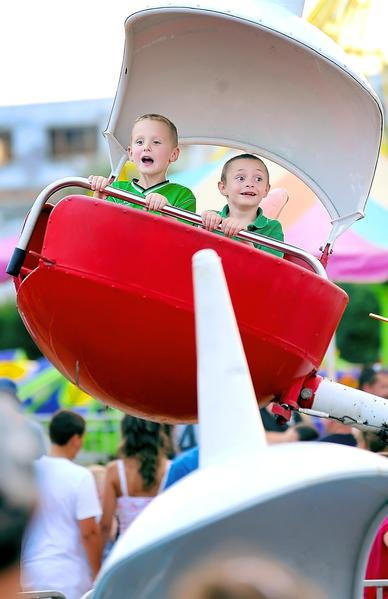 Greencastle residents Logan Gochenauer left age 6 and his friend Nathaniel Seylar right also 6 enjoy the rides at the Greencastle Fireman's Carnival Wednesday night.