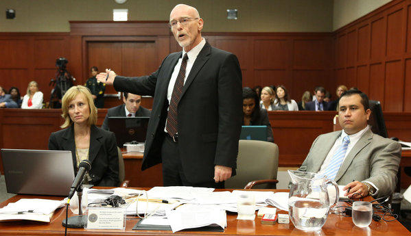 Defense attorney Don West, standing, argues his points on lesser charges to Judge Debra Nelson as George Zimmerman, right, and attorney Lorna Truett listen.